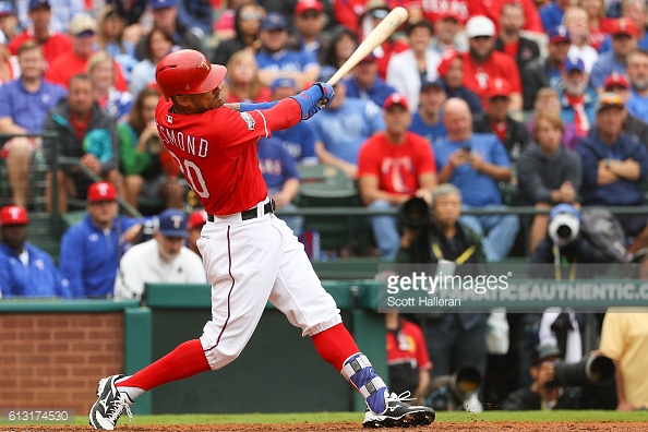 ARLINGTON, TX - OCTOBER 07: Ian Desmond #20 of the Texas Rangers singles home a run in the fourth inning against the Toronto Blue Jays in game two of the American League Divison Series at Globe Life Park in Arlington on October 7, 2016 in Arlington, Texas. (Photo by Scott Halleran/Getty Images)